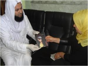 Kurdistan Rasul hands Ali Kalak a booklet about law No. 8