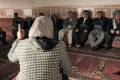 A WADI field worker talks about the dangers of FGM to local officials in a rural area of the Kurdistan Region. (Photo: The National/Florian Neuhof)